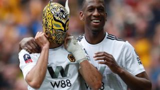 Raul Jimenez celebrates scoring their second goal with Willy Boly