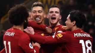 Roberto Firmino celebrates scoring against Wolves