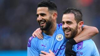 Manchester City's Riyad Mahrez and Bernardo Silva celebrate