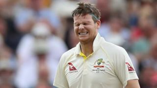 Australia batsman Steve Smith winces after being hit on the helmet by England all-rounder Ben Stokes