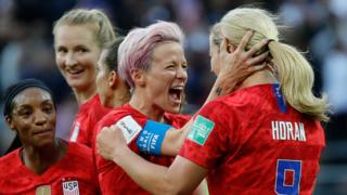 United States' midfielder Lindsey Horan celebrates with forward Megan Rapinoe