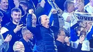 Referee Mike Dean celebrating.