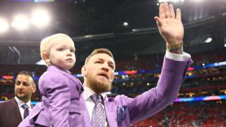 Conor McGregor wqves to the crowd at this year's Super Bowl