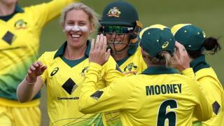 Australia celebrate taking a wicket against England in the Women's Ashes