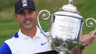 Brooks Koepka lifts the US PGA Championship trophy