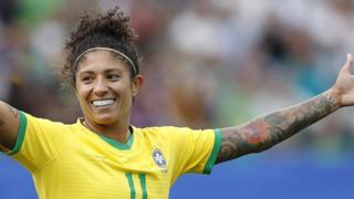 Cristiane celebrates a goal for Brazil
