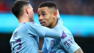 Manchester City's Gabriel Jesus celebrates with Phil Foden