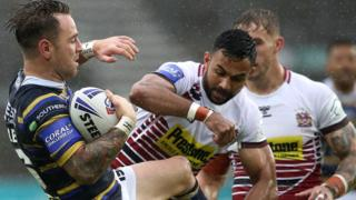 Leeds Rhinos' Richie Myler (left) is tackled by Wigan Warriors' Bevan French