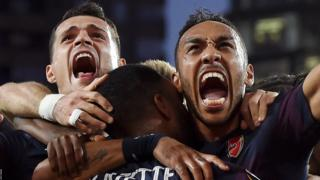 Arsenal's Pierre-Emerick Aubameyang Arsenal celebrates with teammates after scoring