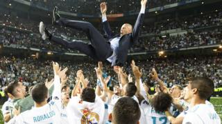 Zinedine Zidane celebrates winning the 2018 Champions League final with the Real Madrid players
