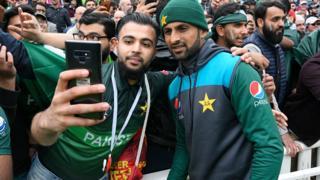 Pakistan fan at Edgbaston poses for a selfie with Shoaib Malik