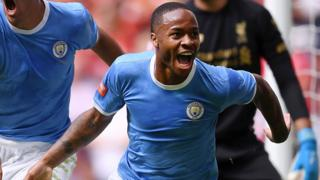 Raheem Sterling celebrates after scoring in the Community Shield