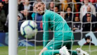 Manchester United goalkeeper David de Gea reacts after Chelsea's equaliser at Old Trafford