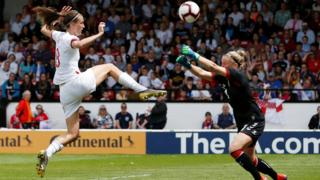 England women's Jill Scott gets to the ball just before the Denmark goalkeeper