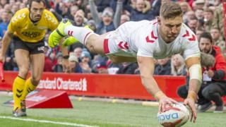 Tommy Makinson scores a try for England