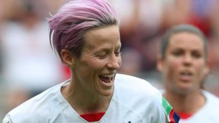 Megan Rapinoe (left) celebrates scoring for USA