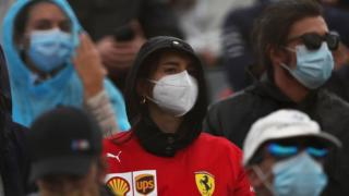 A Ferrari fan wearing a face mask