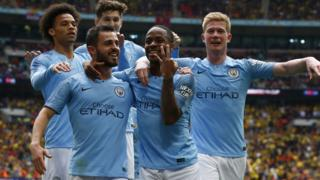 Manchester City players celebrate winning the FA Cup
