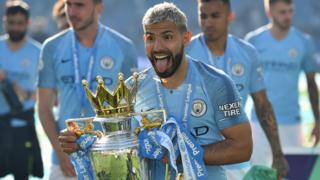 Sergio Aguero with the trophy