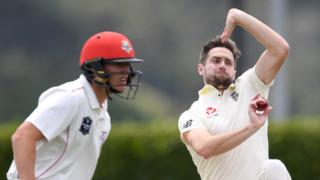 England all-rounder Chris Woakes bowls during a tour match against a New Zealand XI