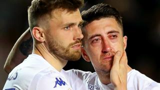 Leeds' Pablo Hernandez is consoled by team-mate Stuart Dallas after their Championship play-off semi-final defeat by Derby