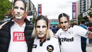 Derby fans in Frank Lampard masks
