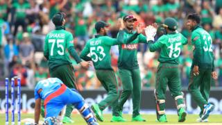 Bangladesh players celebrate taking the wicket of Afghanistan's Hashmatullah