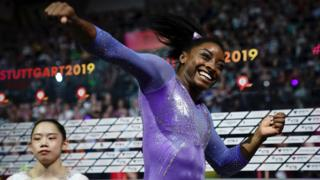 US gymnast Simone Biles celebrates winning balance beam gold at the 2019 World Championships