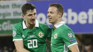 Craig Cathcart congratulates central defensive partner Jonny Evans after his opening goal