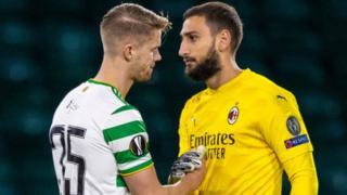 Celtic defender Kristoffer Ajer shakes hands with AC Milan goalkeeper Gianluigi Donnarumma