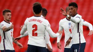England celebrate after scoring against Belgium
