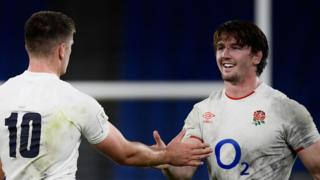 Owen Farrell and Tom Curry high five