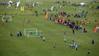 General shot of amateur football matches at Hackney Marshes