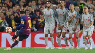 Barcelona's Lionel Messi scores their third goal with a free-kick in the Champions League semi-final against Liverpool