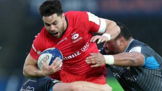 Saracens' Sean Maitland is tackled by Sam Cross and Ma'afu Fia