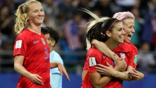 Alex Morgan celebrates with her teammates