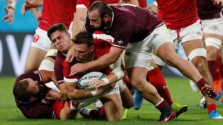 Dan Biggar tackled by three Georgians in the second half