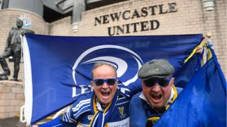 Two Leinster fans all in blue outside St James' Park