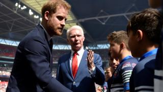 Prince Harry greets mascots ahead of Challenge Cup final