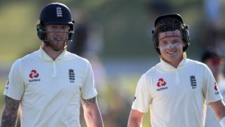 England batsmen Ben Stokes (left) and Ollie Pope (right) smile as they walk off after day one of the first Test against New Zealand