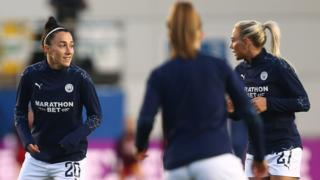Lucy Bronze warms up for Man City
