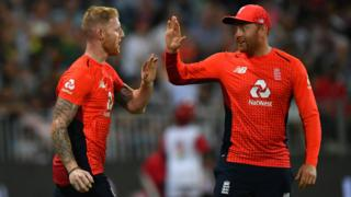 England players Ben Stokes (left) and Jonny Bairstow (right) high five after Stokes takes a catch against South Africa