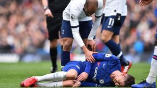 Chelsea's Jorginho lies injured on the field