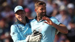 Liam Plunkett celebrates a wicket with Jos Buttler
