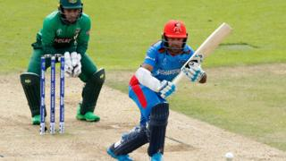 Hashmatullah Shahidi of Afghanistan plays a shot to the leg side