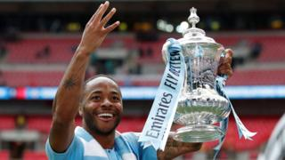 Raheem Sterling celebrates after scoring a hat-trick in the FA Cup final against Watford