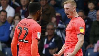 Huddersfield celebrate.