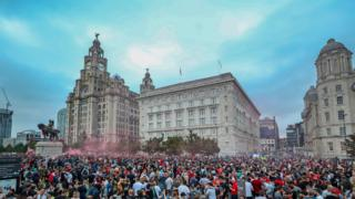 Crowds of Liverpool fans gather outside the Liver Building to celebrate the club's first Premier League title
