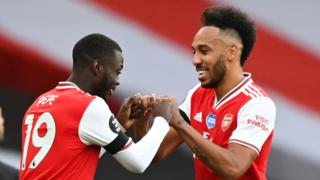 Pierre-Emerick Aubameyang (right) celebrates as Arsenal beat Norwich City 4-0