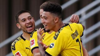 Jadon Sancho celebrates scoring